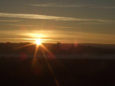 Последние лучи заодящего солнца